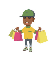 Happy african-american boy holding shopping bags vector