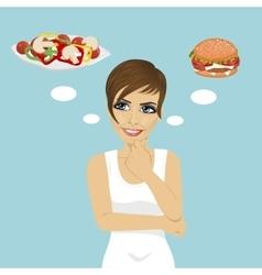 Young woman choosing between hamburger and salad vector