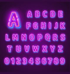 fluorescent neon font on dark background vector image