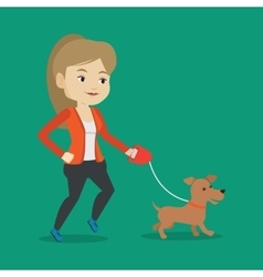Young woman walking with her dog vector image vector image