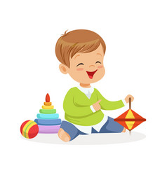 Adorable happy little boy sitting on the floor vector