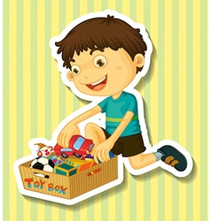 Boy putting toys in the box vector image