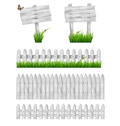 Set of white wooden signs and a fences with grass vector image