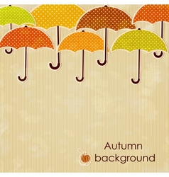 Autumn background with umbrellas vector image