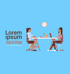 Two indian business woman sitting desk working vector