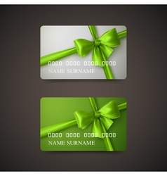 Gift cards with green bow and ribbon vector