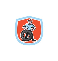 Tireman Mechanic With Tire Cartoon Shield vector image vector image