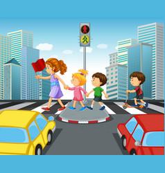 Children crossing street in city vector