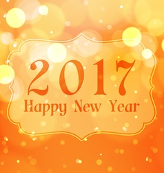 Happy new year 2017 with bokeh lights on orange vector