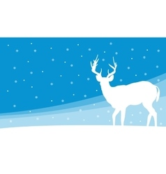 Silhouette of deer on hill winter vector