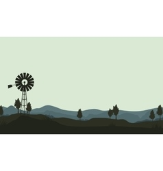 Silhouette windmills on the hill vector