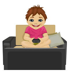 Little boy playing video game at home vector