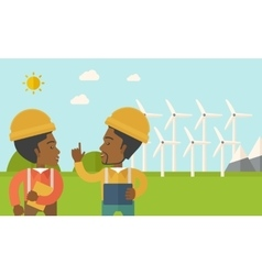 Two black workers talking infront of windmills vector image