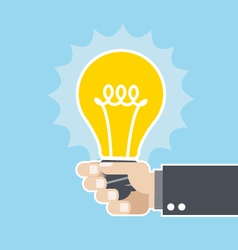 Innovative idea - shining light bulb in hand vector