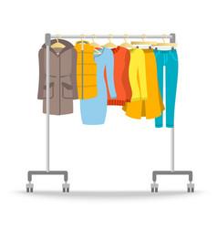 Hanger rack with warm women clothes winter set vector image