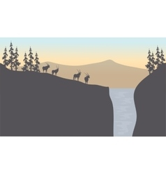 Silhouette of antelope in waterfall vector