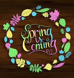 Inscription Spring is coming on wooden background vector image vector image