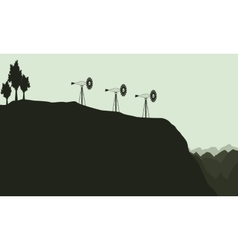 Silhouette of lined windmill landscape vector