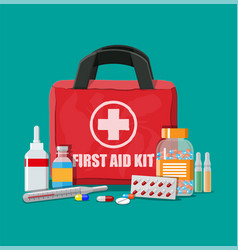 medical first aid kit with pills and thermometer vector image vector image