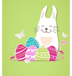 rabbit and eggs on a green background vector image