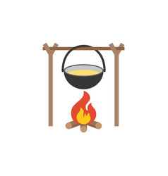 black camping pot over a bonfire vector image