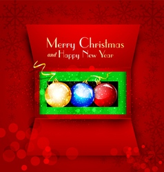 Holiday open box with christmas balls vector
