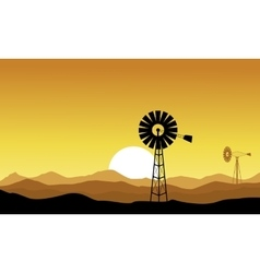 Silhouette of windmill on yellow backgrounds vector image vector image