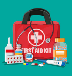 medical first aid kit with pills and devices vector image vector image