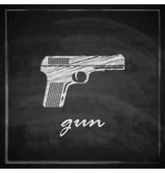 Vintage with gun on blackboard background vector