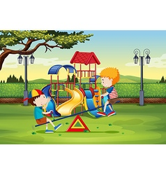 Boys playing on seesaw in the park vector image vector image