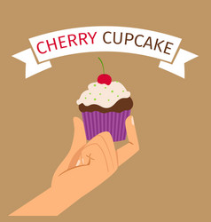 hand holding cupcake with cherry vector image