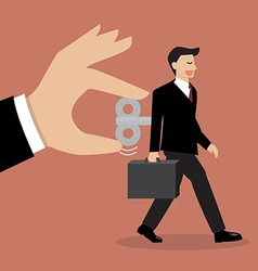 Hand turns on businessman with wind up key in his vector image vector image