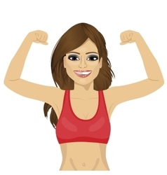 Girl showing her muscles vector