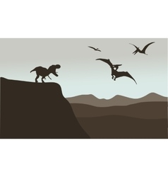 Silhouette of pterodactyl and tyrannosaurus vector