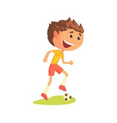 Young soccer player kicking the ball cartoon vector