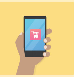 hand with cart icon on mobile phone vector image