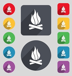 A fire icon sign A set of 12 colored buttons and a vector image vector image