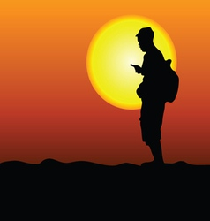 Man in the desert looking at mobile vector