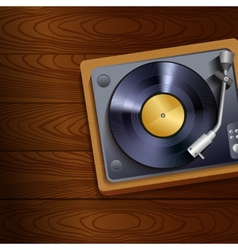 Vinyl record player on wooden background vector image