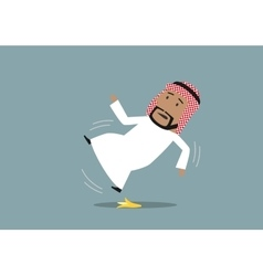 Arabian businessman slipped on a banana peel vector