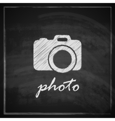 Vintage with camera sign on blackboard background vector