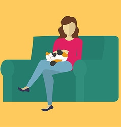 The woman on the couch petting a cat vector
