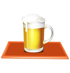 A mug full of cold beer vector