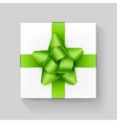 White gift box with green ribbon bow on background vector