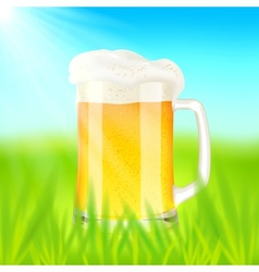 Mug with beer on green field in sunny day vector