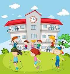 Kids jumping rope at the school ground vector image