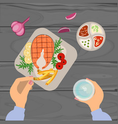 Person is eating grilled fish vector