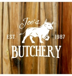 Premium vintage beef bull label on blurred wood vector