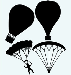 Hot air balloon in the sky and man jumping with pa vector