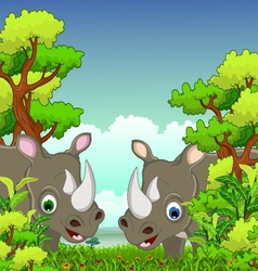 Couple rhino cartoon with forest background vector